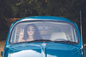VW-Bugwoman-peace-sign-300x200